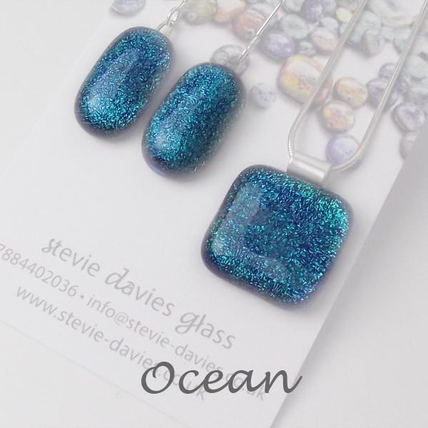 Ocean dichroic glass large jewellery set by Stevie Davies